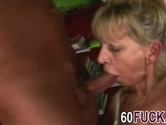 Older blonde manhandles a big cock properly